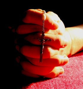 rosary in hand_red